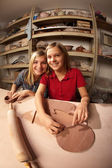 Cute young girls in a clay studio — Stock fotografie