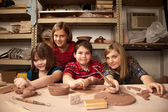 Kids in a clay studio — Stock Photo