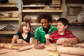 Teacher and students in clay studio — Foto Stock