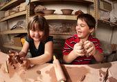 Children in a clay studio — Stock Photo