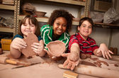 Teacher and students in clay studio — Stockfoto