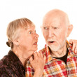Senior woman sharing information with skeptical man — Stock Photo