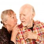 Senior woman sharing information with skeptical man — Stock Photo