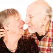 Smiling senior couple touching noses — Stock Photo