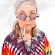 Stock Photo: Senior hippie lady smoking