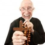 Priest warding off evil — Stock Photo #40081879