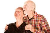 Casal feliz seniuor olhando para cima — Fotografia Stock
