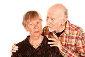 Senior man sharing information with concerned wife — Stock Photo