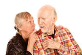 Senior woman sharing information with skeptical man — Foto de Stock