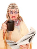 Crazy new age woman in a yellow robe with coffee — Stock Photo