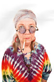 Senior hippie lady smoking — Stock Photo
