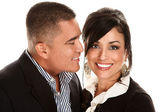Hispanic man kissing Latina woman — Stock Photo