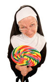 Funny nun with lollipop — Stock Photo