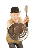 Senior defending himself with spoon and can lid — Stockfoto
