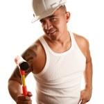 Hispanic man with hammer — Stock Photo #40100485