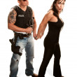 Stock Photo: Policeman arresting pretty woman