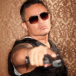 Hispanic Cop Pointing Gun — Stock Photo #40101579