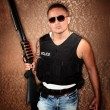 Hispanic Cop Holding Gun — Stock Photo #40101627