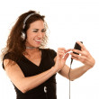 Stock Photo: Pretty womwith handheld audio device