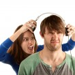 Stock Photo: Wominterupts mwith headphones