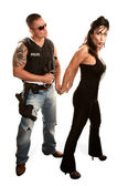 Policeman arresting pretty woman — Stock Photo