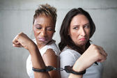 Angry women in handcuffs — Stock Photo