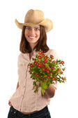 Pretty woman with cowboy hat and flowers — Stock Photo