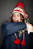 Woman sneezing into her arm — Stock Photo