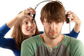 Woman interupts man with headphones — ストック写真