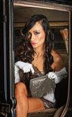 Pretty Woman with Gun in Purse — Stock Photo