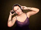 Girl with audio device — Zdjęcie stockowe