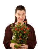 Pretty adult woman with flowers — Stock Photo