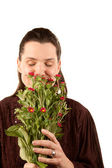 Pretty woman smelling flowers — Stock Photo