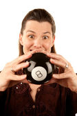 Woman reading the future from a toy eightball — Stock Photo