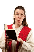 Female pastor finding something shocking in the Bible — Stock Photo