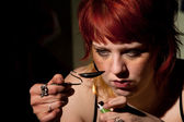 Young woman cooking heroin in a spoon — Stock Photo