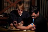 Two men preparing heroin — Stock Photo