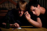 Two young men with heroin or cocaine — Stock Photo