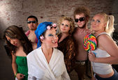 Eccentric woman hanging out with party kids — Stock Photo