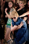 Blonde dancer in blue shirt — Stock Photo