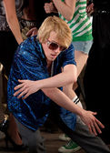 Awkward man dancing low at a 1970s Disco Music Party — Stock Photo