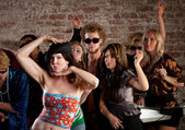 Woman dancing with friends at disco party — Stock Photo