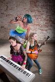 Female punk rock band — Stock Photo
