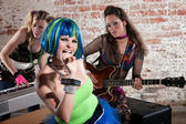 Female punk rock band — Stock Photo