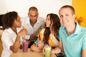 Friends are socializing over smoothies — Stock Photo