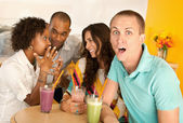 Couples at a cafe drinking frozen beverages — Stock Photo