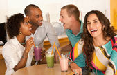 Three people at a cafe drinking frozen beverages — Stock Photo