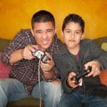 Hispanic Man and Boy Playing Video game — Stock Photo #40314471