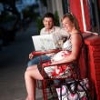 Happy couple sitting outside — Stock Photo
