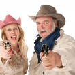 Man and woman aiming guns — Stok fotoğraf